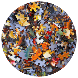 Photo of a pile of puzzle pieces to represent cognitive clutter