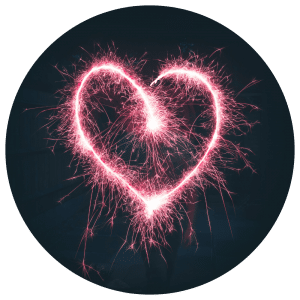 Image of a heart drawn with sparkler to represent health benefits of guided meditation