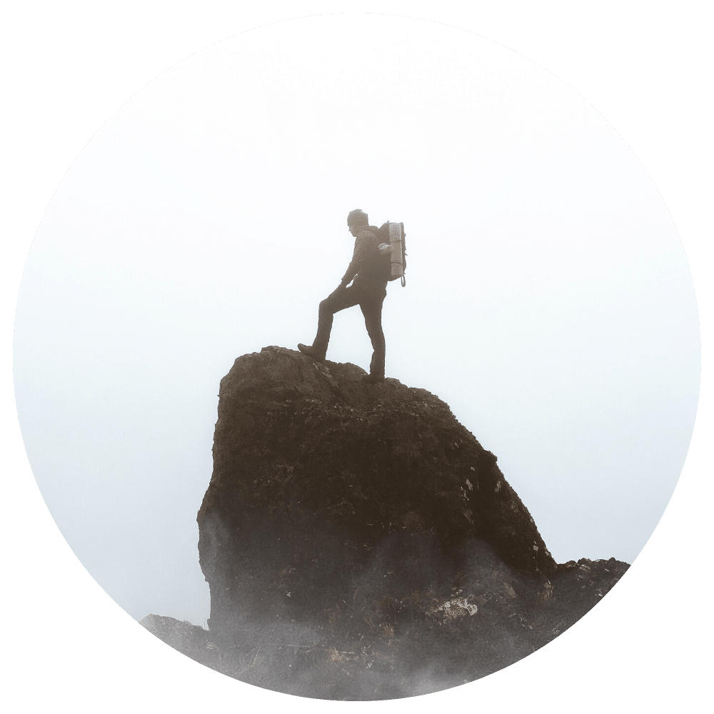 Man standing on top of rock contemplating