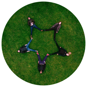 People lying in a field of grass