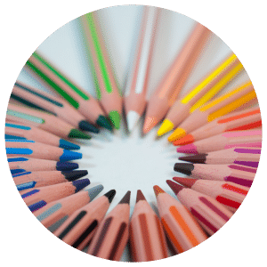 Colored pencils lined up in a circle