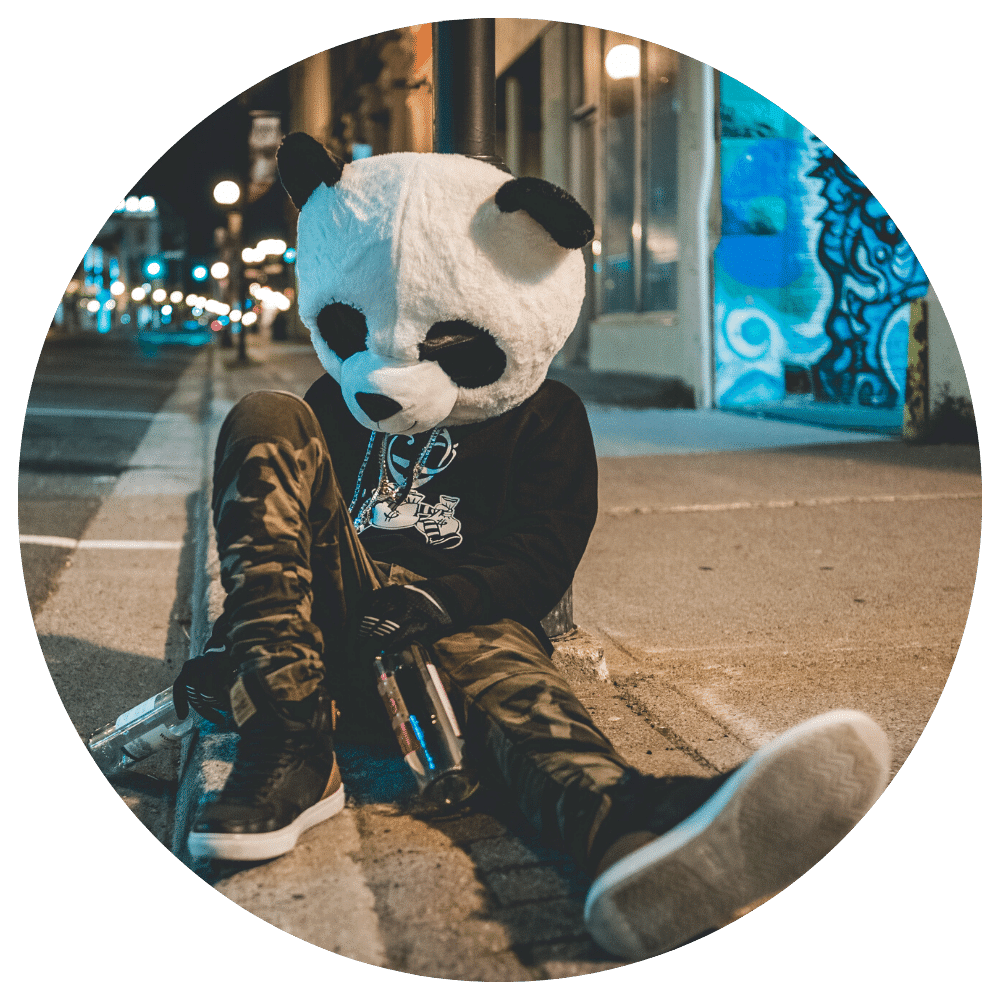 Person in panda outfit drinking
