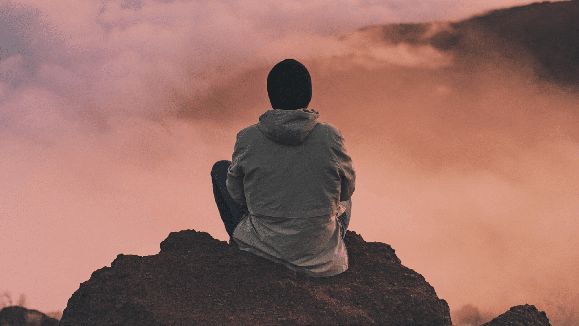 A man meditating on a mountain