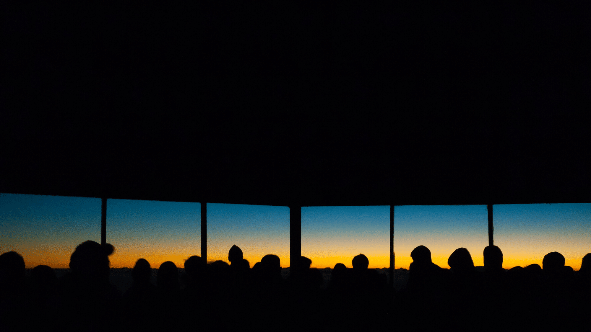 Heads silhouetted against the sunset