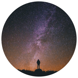 silhouette of woman staring at stars